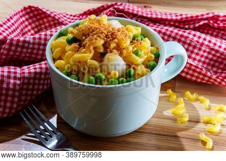 Macaroni And Cheese With Green Peas And Pearl Onions Garnished With Toasted Breadcrumbs