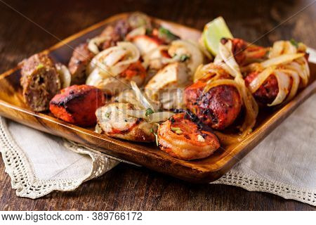 Indian Cuisine Tandoori Oven Baked Platter Of Appetizers Including Malai Tikka Chicken Kebabs Shrimp