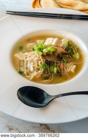 Bowl Of Loaded Japanese Miso Soup With Noodles Tofu Julienned Carrots And Zucchini