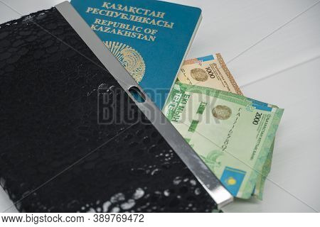 Tenge Money With Passport And Wallet Are On The Table. Tenge In Kazakhstan. Tenge Kzt, Bank Of Kazak