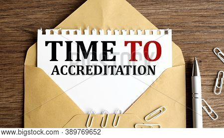 Time To Accreditation, Text On White Paper On Craft Envelope On Wood Background