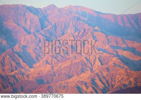 Sunset On A Barren Mountain Range Creating Natural Shadows Taken At The Rural Mojave Desert In Death