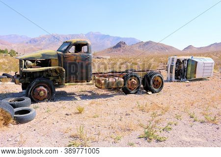 October 4, 2020 In Beatty, Nv:  Abandoned Cars And Trucks On An Arid Desert Plain At An Unofficial J