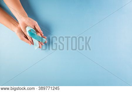 World Diabetes Day Awareness Concept. Hand Holding Blue Ribbon, Symbolic Bow Color Raising Awareness