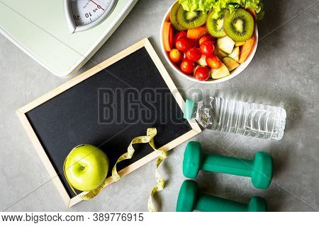 Workout And Diet Health Plan. Sport Exercise Equipment Workout Andgym With Fresh Salad And Green Ap