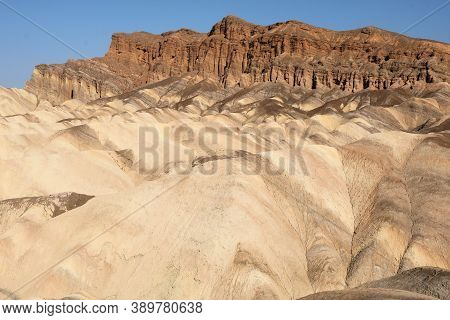 Barren Eroded Mountains With No Vegetation Because Of Little Rainfall Taken At The Arid Mojave Deser