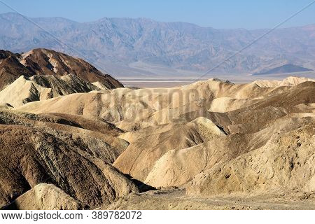 Barren Eroded Hills On Arid Badlands Taken At Zabriskie Point In Death Valley National Park, Ca