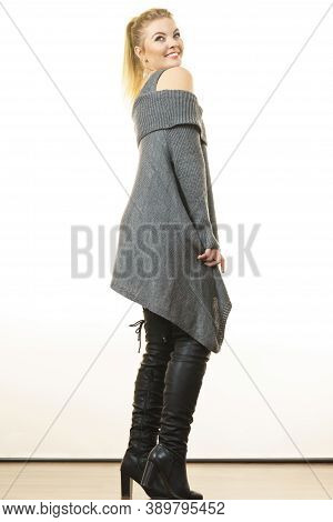 Woman In Ponytail Wearing Gray Long Top Sweater Tunic, Black Tights. Stylish, Autumnal Outfit.