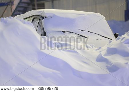 Van Car Covered With Deep Cover Of White Snow Drift Snowbank At Night Winter Vacation Trip Resort We