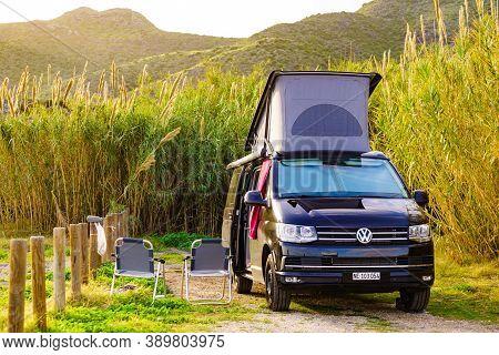 Cala Reona, Murcia, Spain - December 27, 2019: Volkswagen Camper Van With Roof Top Tent Camping On M