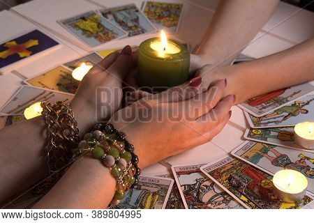 Bangkok,thailand,march.15.20.female Hands Hold A Lighted Candle In The Dark At Night. A Fortune Tell