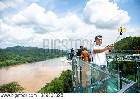 Tourists Walk And Take Pictures On The Sky Walk, A New Landmark, The Mekong's Viewpoint. Chiang Khan
