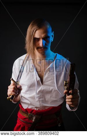 Kozak With Weapons In National Ukrainian Clothes. A Young Man With A Forelock, In A White Shirt And