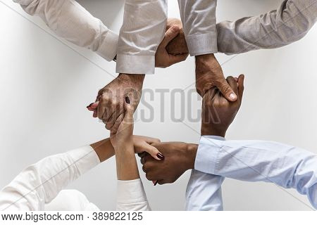 A Group Of Multi Ethnicity Hands Holding Each Other In A Huddle