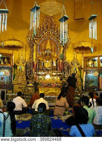 Yangon, Myanmar - 04 Jan 2010: The People In The Ancient Temple In Yangon, Rangoon, Myanmar