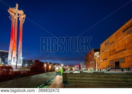 Gdansk, Poland - October 11, 2020: Three crosses monument at the European Solidarity square in Gdansk, Poland. It's a memorial to the Fallen Shipyard Workers killed in 1970 at  the Lenin Shipyard.