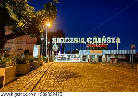 Gdansk - October 11, 2020: Historic gate to the Gdansk Shipyard at European Solidarity Square in Gdansk at night. Poland