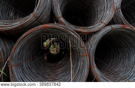 Closeup Steel Wire Coil. Metal Steel Reinforced For Concrete Construction. Iron Wire For Constructio