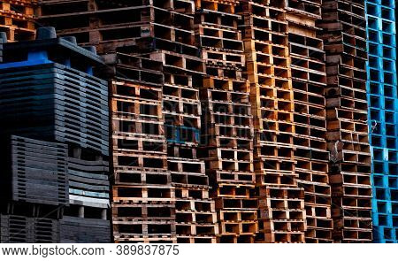 Pile Of Old Wooden Pallet. Industrial Wood Pallet Stacked At Factory Warehouse. Cargo And Shipping C