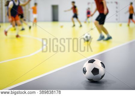 Indoor Futsal Soccer Players Playing Futsal Training. Indoor Soccer Sports Hall. Futsal Players Kick