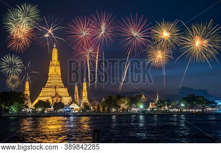 Beautiful View Of Wat Arun Temple With Fireworks New Year Celebration At Twilight Time In Bangkok, T