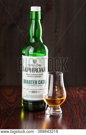 Trondheim, Norway - Mai 18 2020: Laphroaig Quarter cask single malt scotch whisky bottle and glass