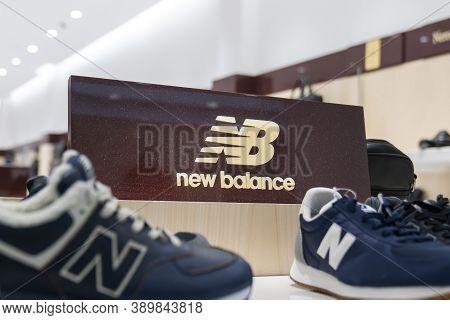 Krasnoyarsk, Russia, October 15, 2020: New Balance Sneakers And The Footwear Company Logo. Showcase