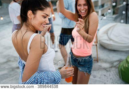 Group Of Happy Young People Friends Dancing And Having Fun In Party