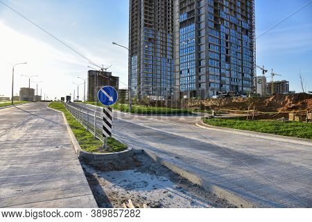 Road Works Activity At Construction Site. Construction And Development Projects On Roads In City. Ro
