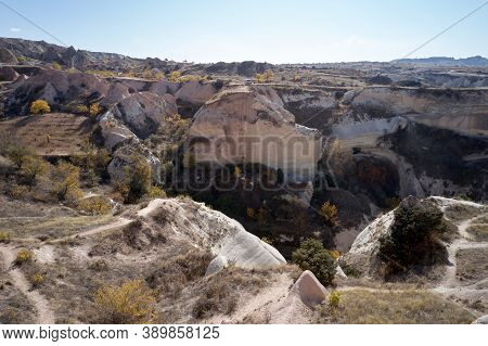 Volcanic Rock Formations Landscape. Valley With Volcanic Tuff Stone Rocks In Goreme, Cappadocia, Tur