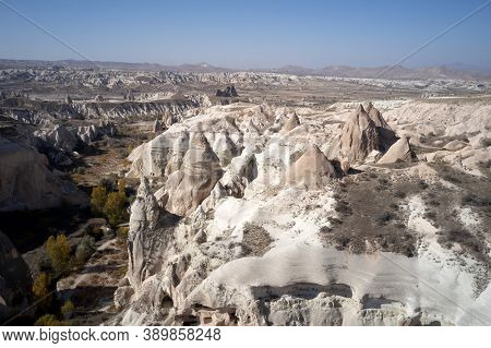 Goreme Valley With Unique Rock Formations. Panorama With Sandstone Formations In Cappadocia, Turkey.