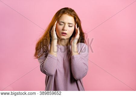 Bored Woman With Red Hair Having Headache, Studio Portrait. Girl Putting Hands On Head, Isolated On