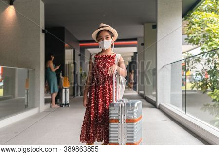 Pretty Asian Girl Happy Tourists To Travel Wearing Mask To Protect From Covid-19 On They Holidays