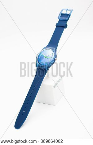London, Gb 07.10.2020 - Blue Swatch Cheapest Swiss Made Quartz Watch On Brand Showcase Stand. Colore