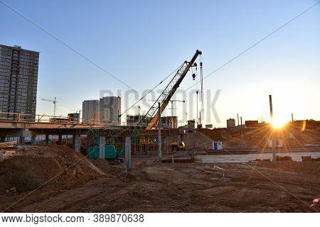 Mobile Telescopic Boom Crane On Bridge Construction. Truck Crane Work On Building Bridges. Road Work