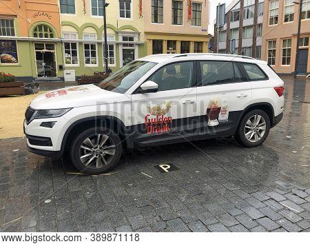 Vlissingen, The Netherland - October 13, 2020: Gulden Draak Service Car Parked In A Public Parking L