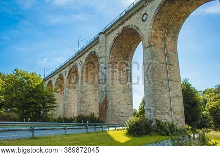 Train Viaduct In Altenbeken,  North Rhine Westphalia, Germany. Old Stone Railway Surrounded By Green