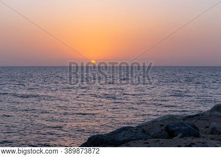 Plain Golden Sunset Over The Gulf In Dubai, United Arab Emirates, Seen From Bluewaters Island.