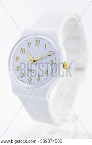 London, Gb 07.10.2020 - Swatch Cheapest Swiss Made Quartz Watch On Stand Close Up. White Plastic Cas