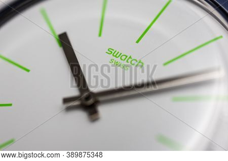Geneve, Switzerland 07.10.2020 - Swatch Logo On White Wristwatch Dial Of Swiss Made Quartz Watch Clo