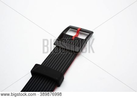 London, Gb 07.10.2020 - Swatch Logo On Black Wrist Strap Of Swiss Made Watch Isolated On White Backg