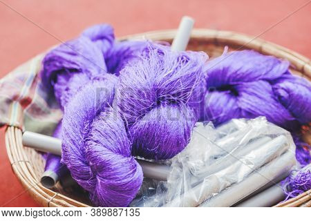 Coils Of Violet Coloured Silk Thread. Natural Product Silkworm Butterflies Cocoons. Manual Productio