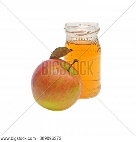 One Whole Apple With Leaf And A Small Bottle Of Apple Cider Vinegar Isolated On White Background