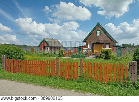 Traditional Wooden Cottages At Lake In Idyllic Mecklenburg Lake District,germany