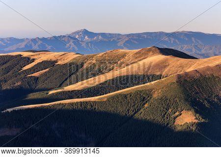 Sunrise In Fagaras Mountains, Romania. In Background  Cozia Mountains.