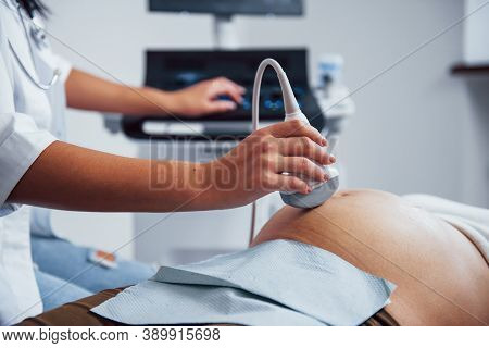 Female Doctor Does Ultrasound For A Pregnant Woman In The Hospital.