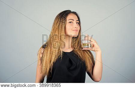 Beauty Never Sleeps. Sexy Girl Hold Perfume. Toilette Water. Woman With Bottle Of Perfume. Girl Appl