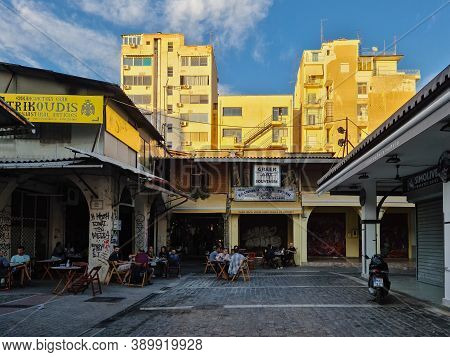 Thessaloniki, Greece - October 14 2019: Hellenic Dining Evening Scene Of People At Outdoors Tavern R