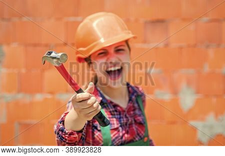 Little Girl In Hard Hat Holds Hammer. Best Repairer Ever. Learning To Use Hammer. Hammering. She Is