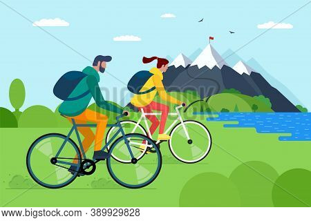 Young Couple Riding Bicycles In Mountains. Boy And Girl Bicyclists With Backpacks On Bikes Travel In